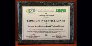 """The Aurora Area Convention and Visitors Bureau has received a community service award for its """"advance of parks, recreation, and leisure"""" both locally and across Illinois."""